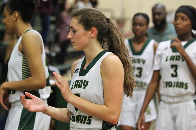 Lincoln's Kailey Schuchts claps after the Trojans' girls basketball team beat Niceville 72-68 during a Region 1-8A semifinal on Feb. 19, 2019.