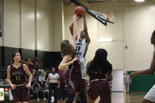 Lincoln's Kayley Farmer hits a clutch jumper as the Trojans' girls basketball team beat Niceville 72-68 during a Region 1-8A semifinal on Feb. 19, 2019.