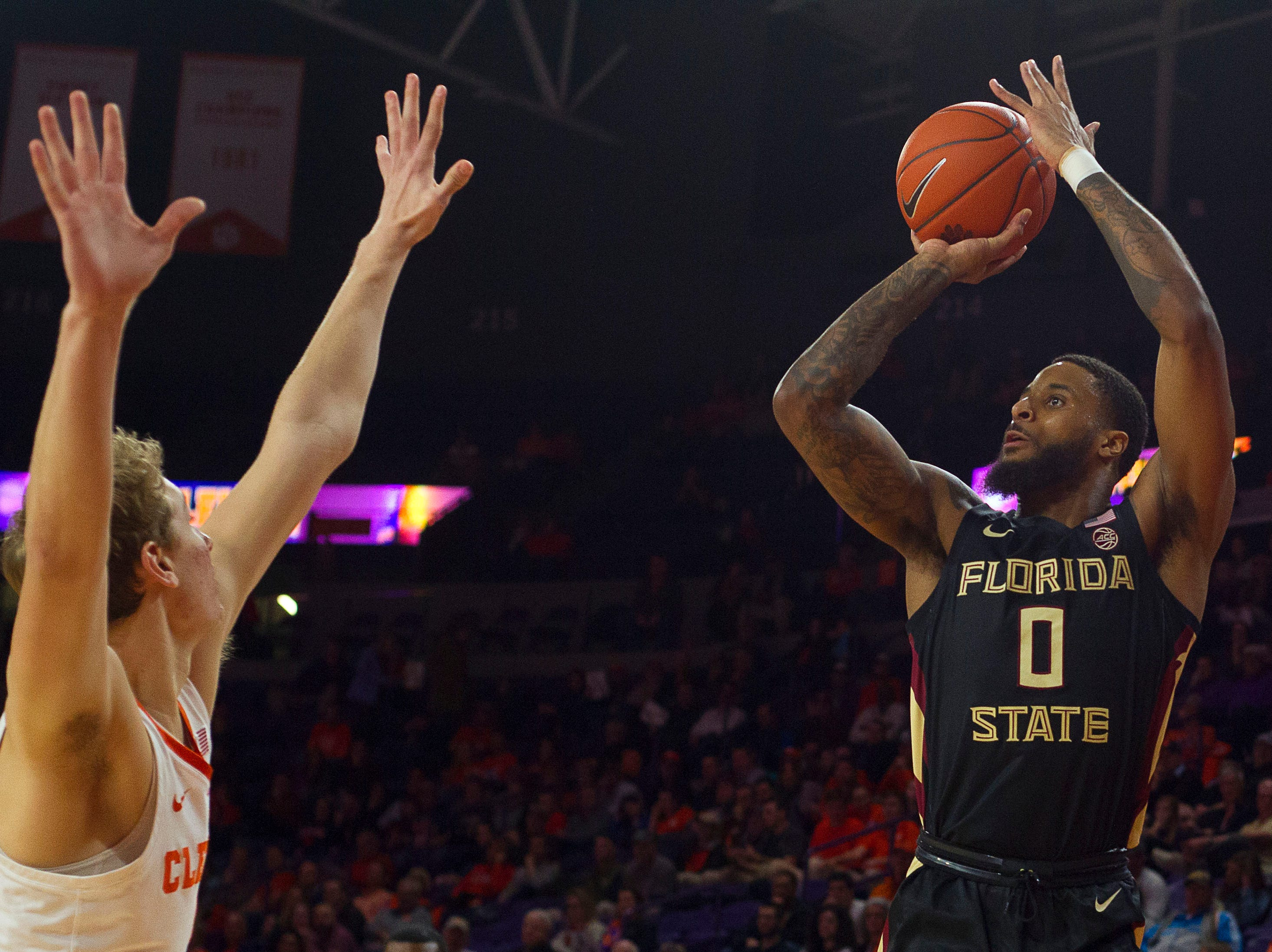 Feb 19, 2019; Clemson, SC, USA; Florida State Seminoles forward Phil Cofer (0) shoots the ball while being defended by Clemson Tigers forward Hunter Tyson (5) during the first half at Littlejohn Coliseum. Mandatory Credit: Joshua S. Kelly-USA TODAY Sports