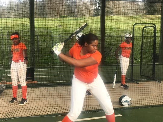 FAMU junior outfielder Jamesia Stoudemire works on hitting in the cage during practice. She was selected as a preseason All-MEAC second-team player.
