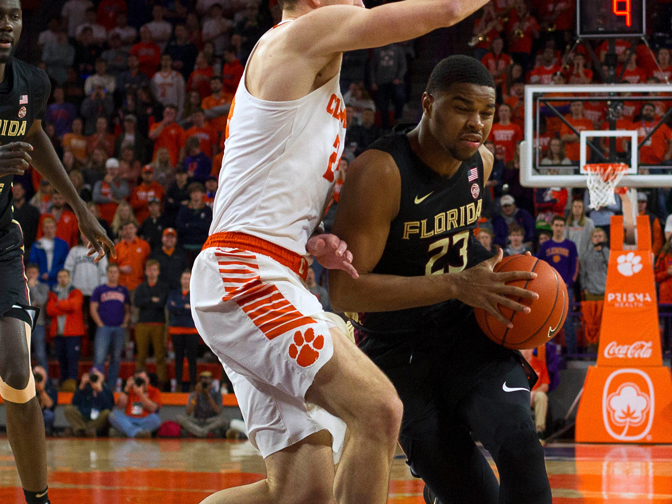 Feb 19, 2019; Clemson, SC, USA; Florida State Seminoles guard M.J. Walker (23) moves to the basket while being defended by Clemson Tigers forward David Skara (24) during the first half at Littlejohn Coliseum. Mandatory Credit: Joshua S. Kelly-USA TODAY Sports