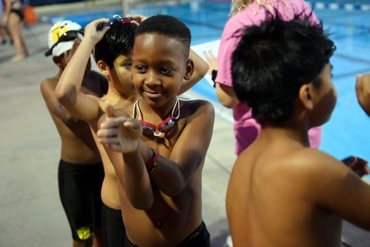 Samuel Hope, 9, waits his turn to enter the pool with fellow competitors on Friday, Feb. 15, 2019, during the Winter 2019 Swim Meet at the North County Aquatics Center sponsored by Float Hope Now of Indian River County. Hope, who swims at the Gifford Youth Achievement Center pool, has been swimming for three years and has dreams of swimming in the Olympics.