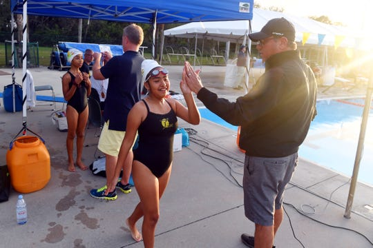 Gabriela Rojo, 10, gets a high-five from Scott Barlow on Friday, Feb. 15, 2019, after competing in an event at the Float Hope Now of Indian River County Winter 2019 Swim Meet at the North County Aquatic Center. Float Hope Now is a non-profit organization with a mission to teach kids swimming as a life skill and build confidence.