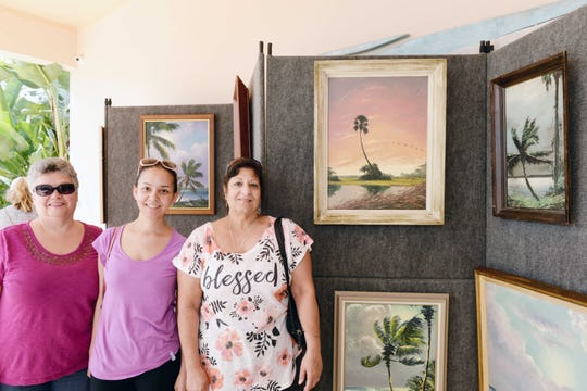 Elva and Ericka Lamboy, left, with Joanna Toledo at the Backus Museum for the Highwaymen Celebration Weekend Feb. 15-17.