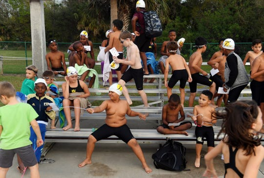 About 100 children crowd the deck of the North County Aquatic Center on Friday, Feb. 15, 2019, before the start of the Float Hope Now of Indian River County Winter 2019 Swim Meet. The children, ages six to 14, competed in several races as friends and family looked on.