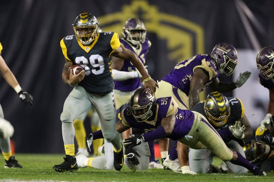 Oxnard High graduate Terrell Watson breaks through the line during the San Diego Fleet's game against the Atlanta Legends in an AAF game on Sunday.