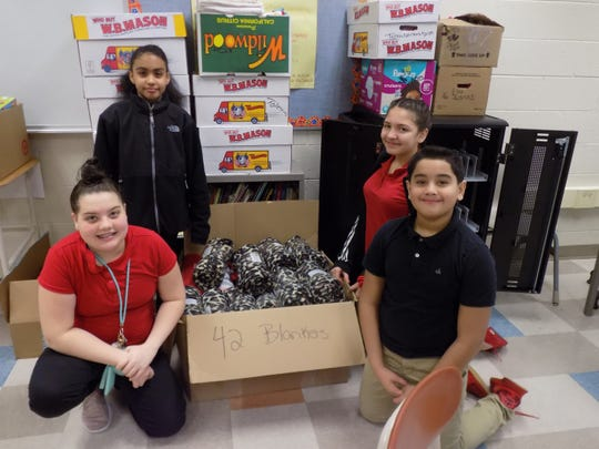 Students at Wallace Middle School collected 42 blankets for homeless people as part of their second annual Martin Luther King Jr. Day of Service project.