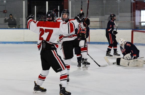 Rye forward Declan Lavelle celebrates a first-period goal with Sasha Vasyuta (27) Tuesday, Feb. 19, 2019 at Playland Ice Casino. It was the first of his three goals in a 6-2 playoff win over Byram Hills.