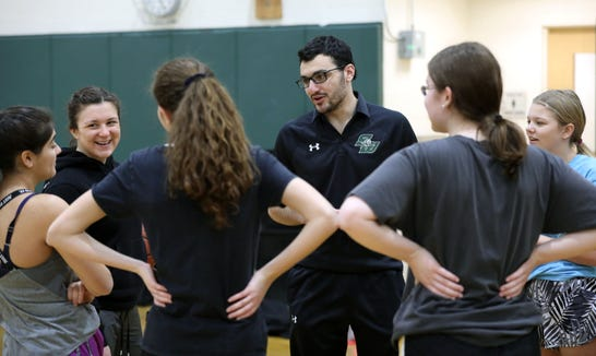 Matthew Werner, the head coach for the Solomon Schechter girls basketball team in Hartsdale, chats with the team before practice, Feb. 20, 2019.