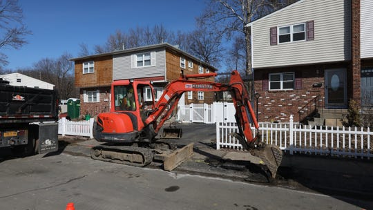 A sidewalk is being torn up on Lonergan Dr. in the Squires Gate neighborhood of Suffern Feb. 19, 2019.