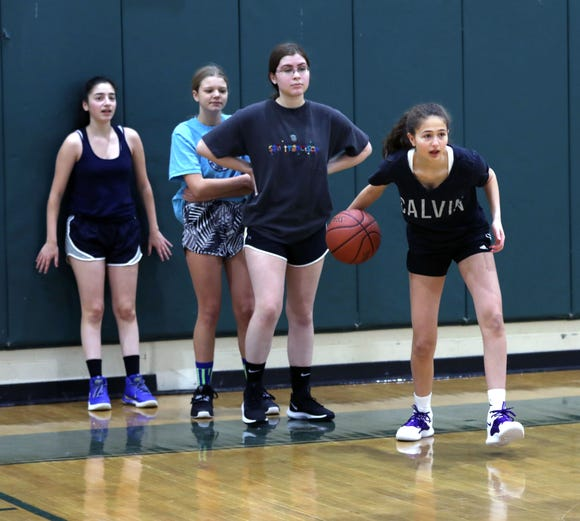 Ella Rembaum, right, a freshman with the Solomon Schechter girls basketball team in Hartsdale, rolls the ball to a teammate during practice at the school, Feb. 20, 2019.