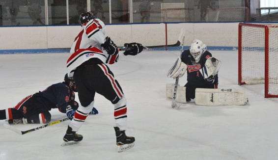 Byram Hills goalie Ben Sfarra gloves a shot by Sasha Vasyuta in the opening minutes of the Division II opening-round game.