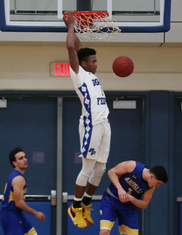 Dobbs Ferry's Dimaunie Meredith (1) slams down one of his three dunks against Ardsley during boys basketball playoff action at Hobbs Ferry High School Feb. 19,  2019.