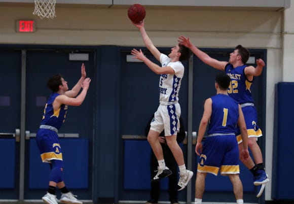 Dobbs Ferry's Patrick Straub (5) drives to the basket against Ardsley during boys basketball playoff action at Hobbs Ferry High School Feb. 19, 2019.