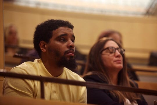 Jacquez Robinson sits beside his attorney Natalie Woloshin in February as the Delaware Supreme Court heard arguments over whether murder charges against him should be reinstated.