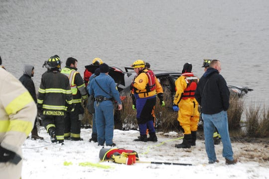 A 35-year-old woman is listed in critical condition after being pulled from her car that rolled into a pond off of Del. 1