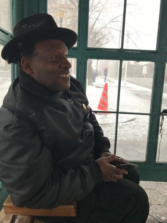 Kenny Robinson was playing R&B music at a bus stop at Rodney Square Wednesday and enjoying the snow.