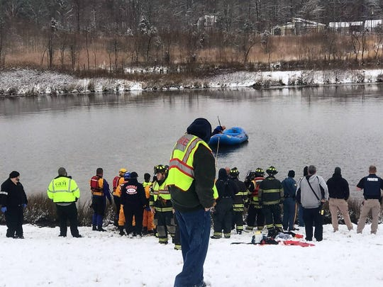 First responders look on as teams search Drawyers Creek near Willey Farms on Wednesday for potential occupants in a submerged car.