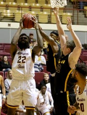 Midwestern State's Gilbert Thomas goes for a layup and is fouled by a Cameron defender Tuesday, Feb. 19, 2019, in D.L. Ligon Coliseum at MSU Texas. The Mustangs defeated the Aggies 62-59.