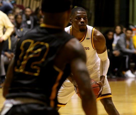 Midwestern State's D'monta Harris looks to pass in the game against Cameron Tuesday, Feb. 19, 2019, in D.L. Ligon Coliseum at MSU Texas. The Mustangs defeated the Aggies 62-59.