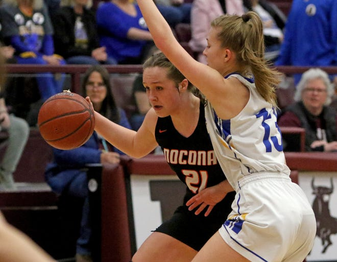 Nocona's Averee Kleinhans dribbles by Brock's Olivia Lewis in the Region I-3A quarterfinal Tuesday, Feb. 19, 2019, in Bridgeport.