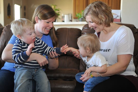 Kristin Crumb, left, holds her son, Trevor, 2, while playing with 20-month-old Axel Brock, and his mom, Misti Wednesday morning. Both Trevor and Axel were born with down syndrome. Kristin and Misti have organized a nonprofit called Upside to help raise funds to build an inclusive playground in Wichita Falls.