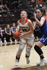 Muenster's Kaitlin Hennigan drives to the basket against Windthorst. Hennigan finished the night with 15 points and Muenster advanced to the Regional Semi-Finals.