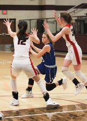 Windthorst's Sadie Anderle dribbles through traffic against Muenster Tuesday, February 19, 2019 at the Regional Quarterfinals.