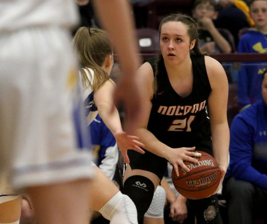 Nocona's Averee Kleinhans looks to pass against Brock in the Region I-3A quarterfinal Tuesday, Feb. 19, 2019, in Bridgeport.