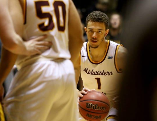 Midwestern State's Elijah Lee dribbles in the game against Cameron Tuesday, Feb. 19, 2019, in D.L. Ligon Coliseum at MSU Texas. The Mustangs defeated the Aggies 62-59.