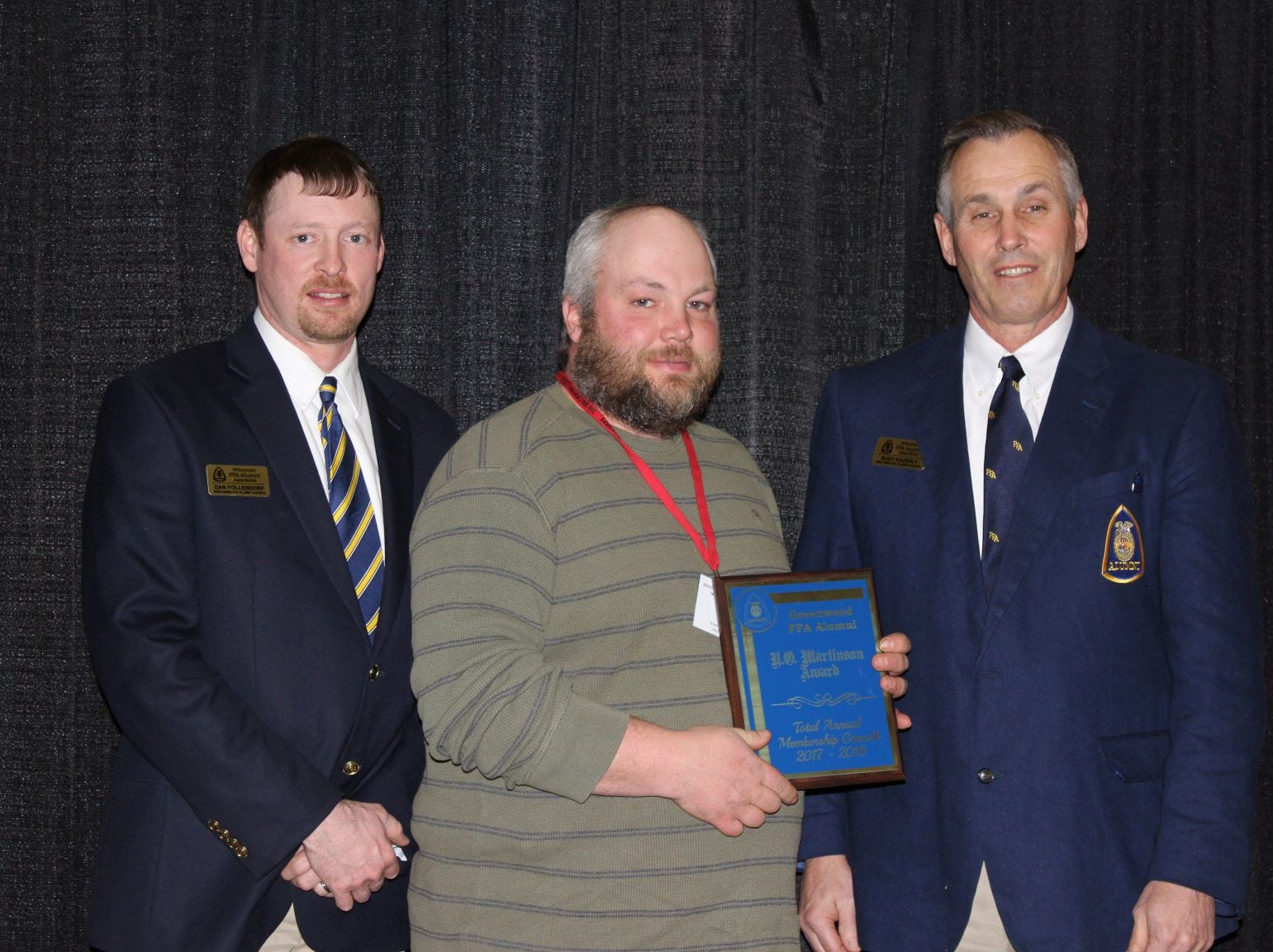 Dan Follendorf (left) and Rudy Kaderly of the WI FFA Alumni Association present present Greenwood FFA Alumni with the Dr. V.O. Martinson Award, given to the FFA Alumni with the greatest increase in annual membership percentage.