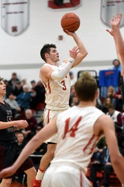 Sheridan's Ethan Heller goes up for a shot against John Glenn. Heller was voted the Division II boys player of the year, as the Southeast District basketball teams were released on Friday.