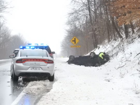 Icy conditions caused a car to flip over on OH-146 Wednesday morning.