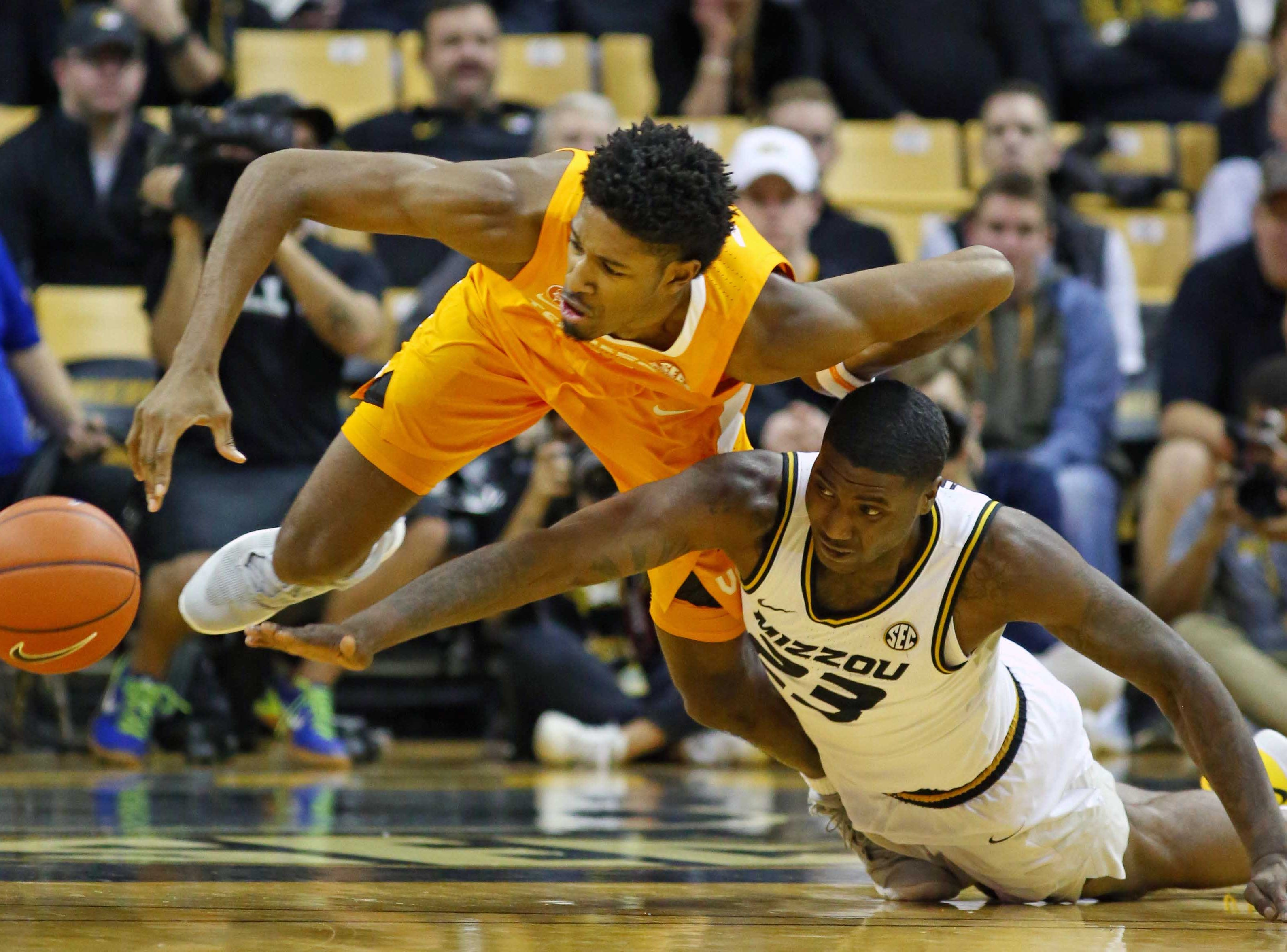Jan. 8: Tennessee Volunteers forward Kyle Alexander (11) and Missouri Tigers forward Jeremiah Tilmon (23) dive for a loose ball in the second half at Mizzou Arena.