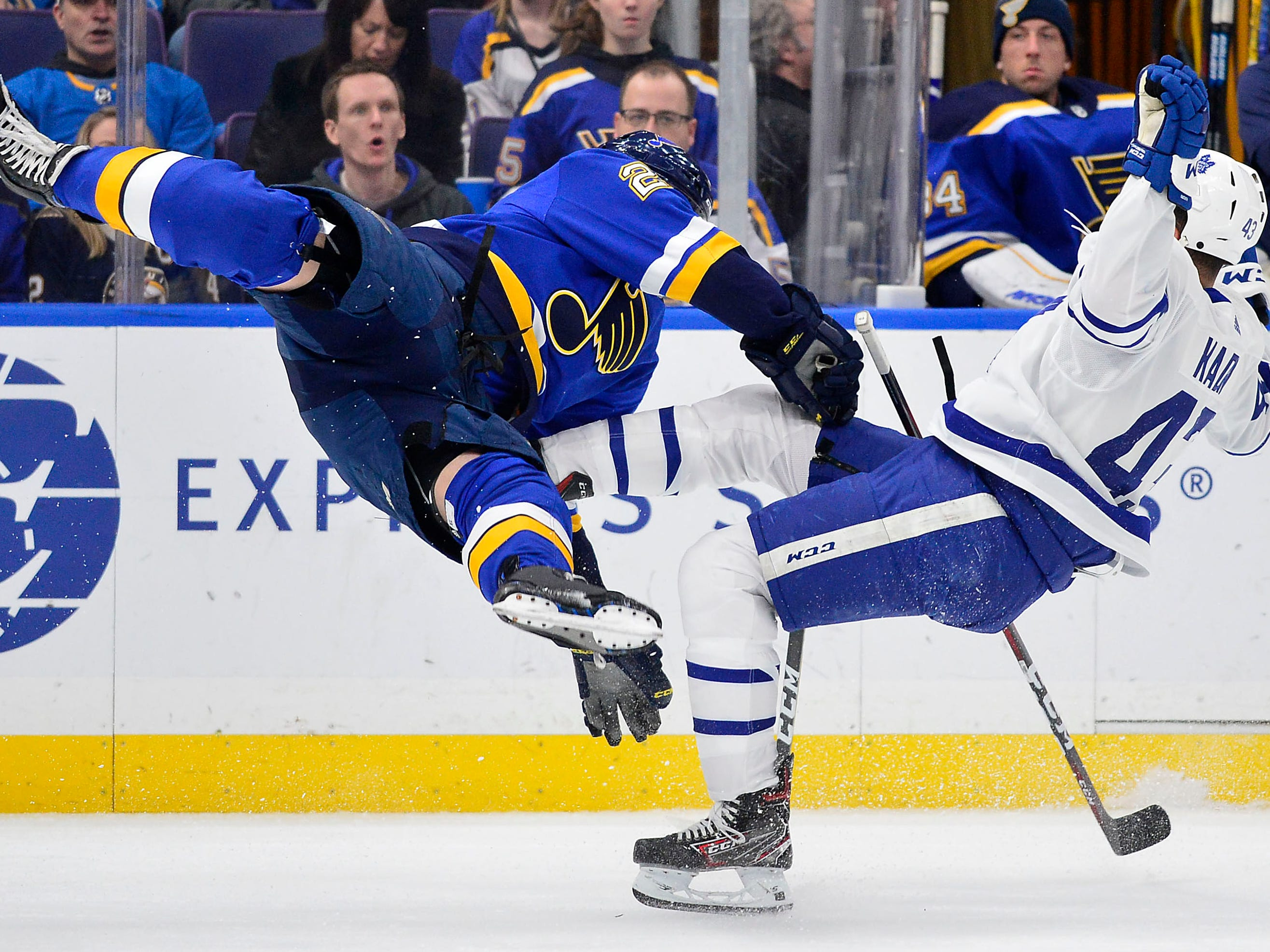Feb. 19: Toronto Maple Leafs center Nazem Kadri, right, is checked by St. Louis Blues defenseman Vince Dunn. The Maple Leafs later announced that Kadri had a concussion.