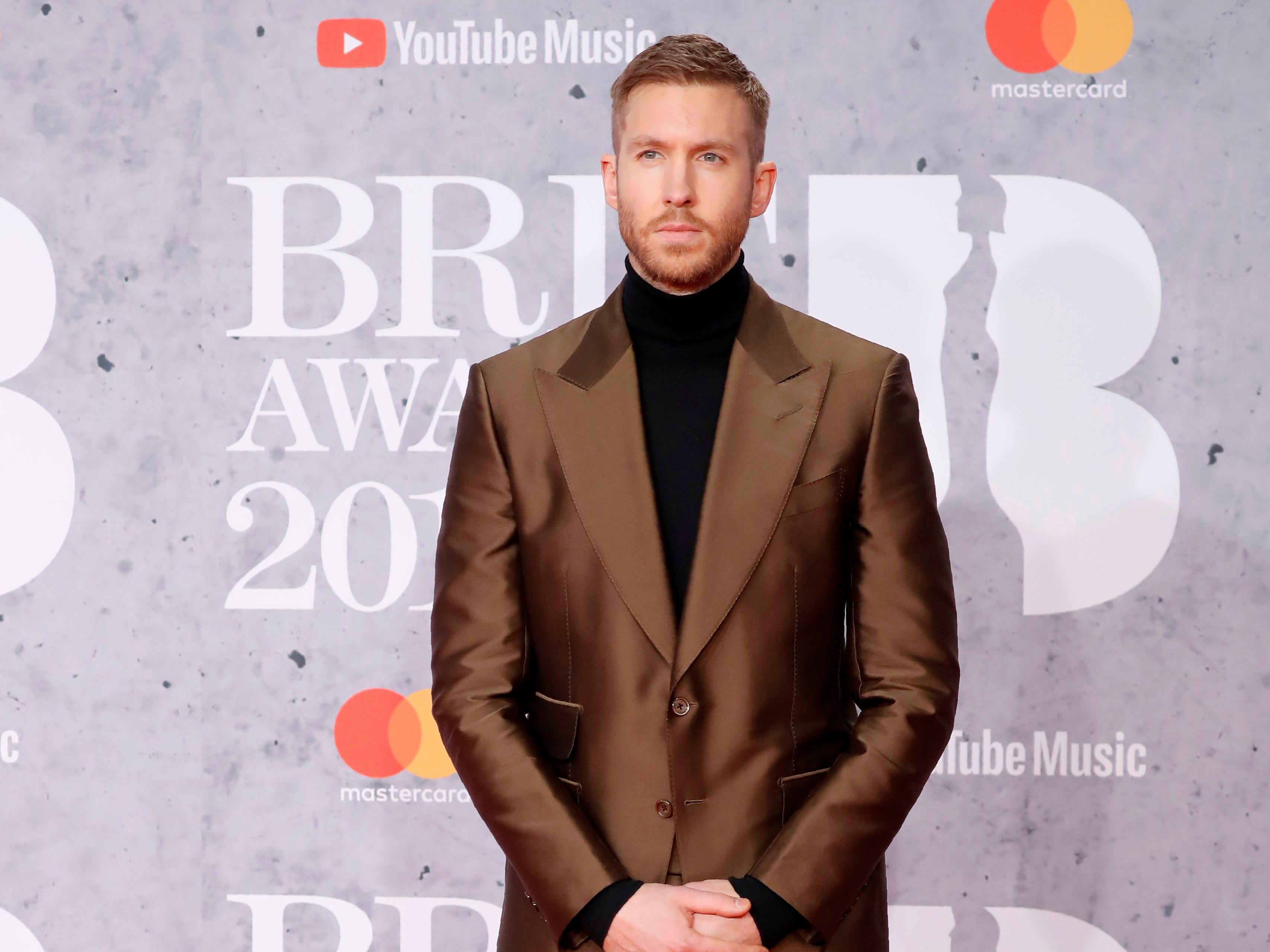 British DJ and musician Calvin Harris poses on the red carpet on arrival for the BRIT Awards 2019 in London on February 20, 2019. (Photo by Tolga AKMEN / AFP) / RESTRICTED TO EDITORIAL USE  NO POSTERS  NO MERCHANDISE NO USE IN PUBLICATIONS DEVOTED TO ARTISTSTOLGA AKMEN/AFP/Getty Images ORIG FILE ID: AFP_1DO1DB