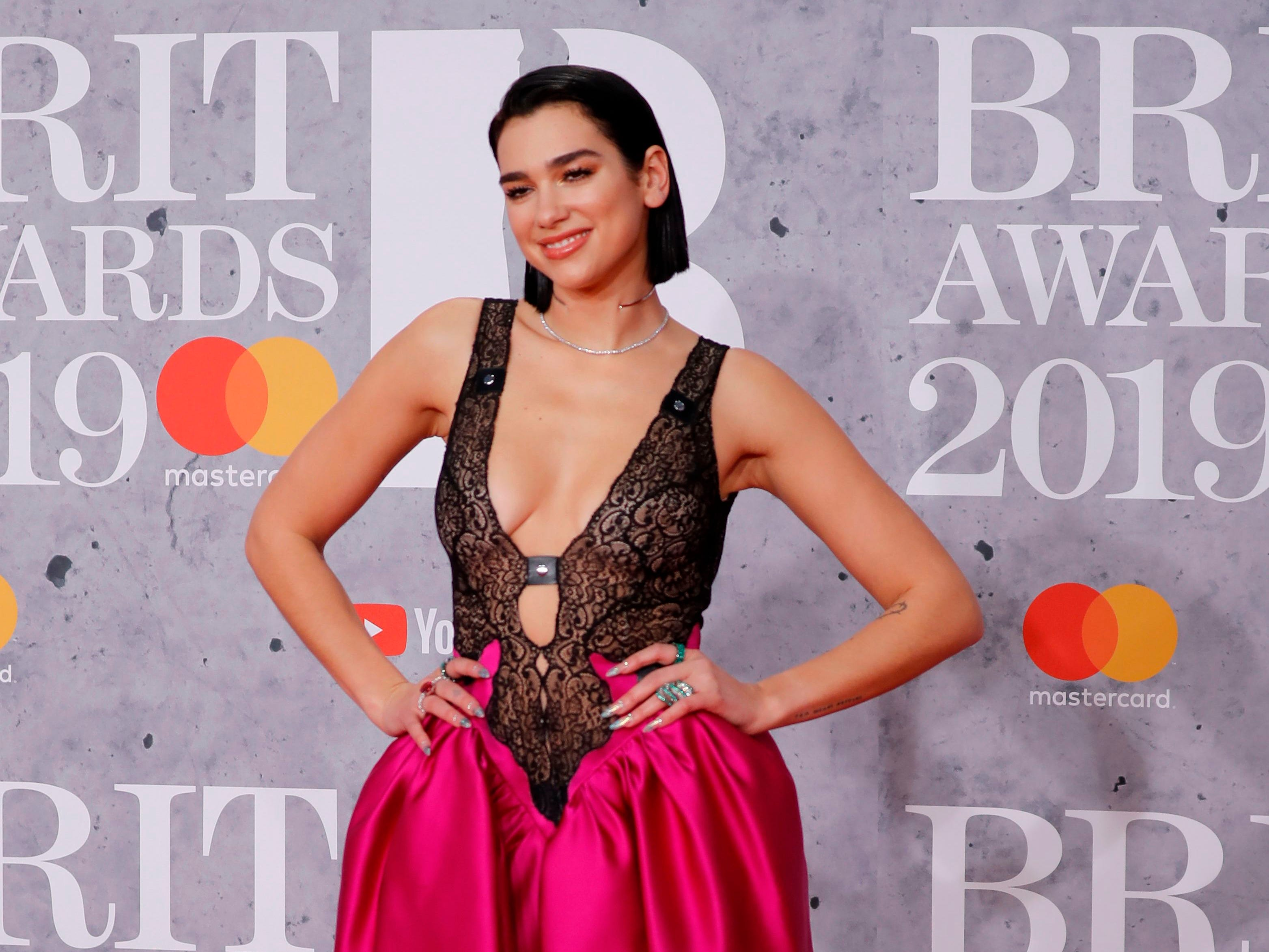 British singer-songwriter Dua Lipa poses on the red carpet on arrival for the BRIT Awards 2019 in London on February 20, 2019. (Photo by Tolga AKMEN / AFP) / RESTRICTED TO EDITORIAL USE  NO POSTERS  NO MERCHANDISE NO USE IN PUBLICATIONS DEVOTED TO ARTISTSTOLGA AKMEN/AFP/Getty Images ORIG FILE ID: AFP_1DO108