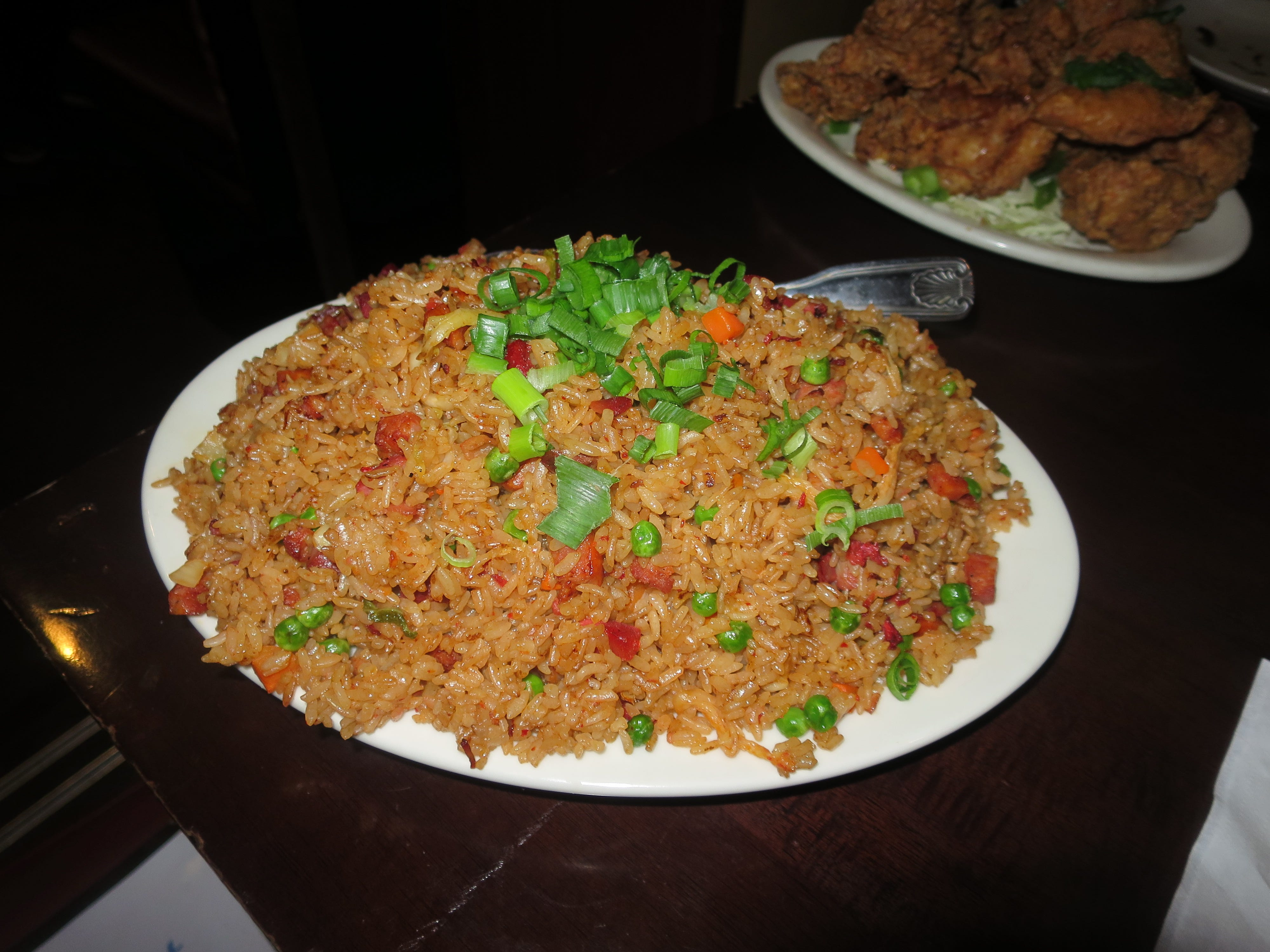 "Fried rice is the signature dish at the Side Street Inn, served in mountainous portions and laden with meat. This is the ""The Works"" version and it has four different kinds of pork, plus kimchee."