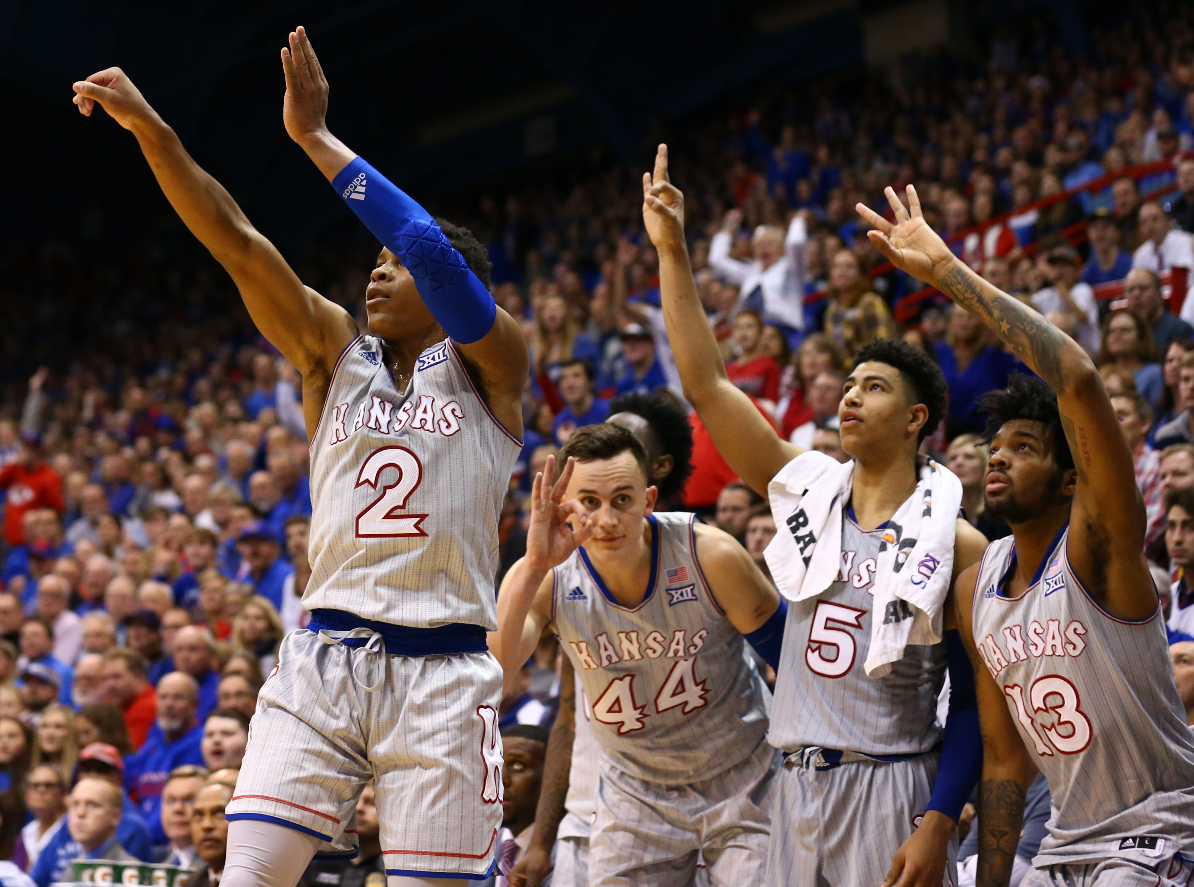 Dec. 18: The Kansas Jayhawks bench celebrates as guard Charlie Moore (2) scores against the South Dakota Coyotes in the second half at Allen Fieldhouse.
