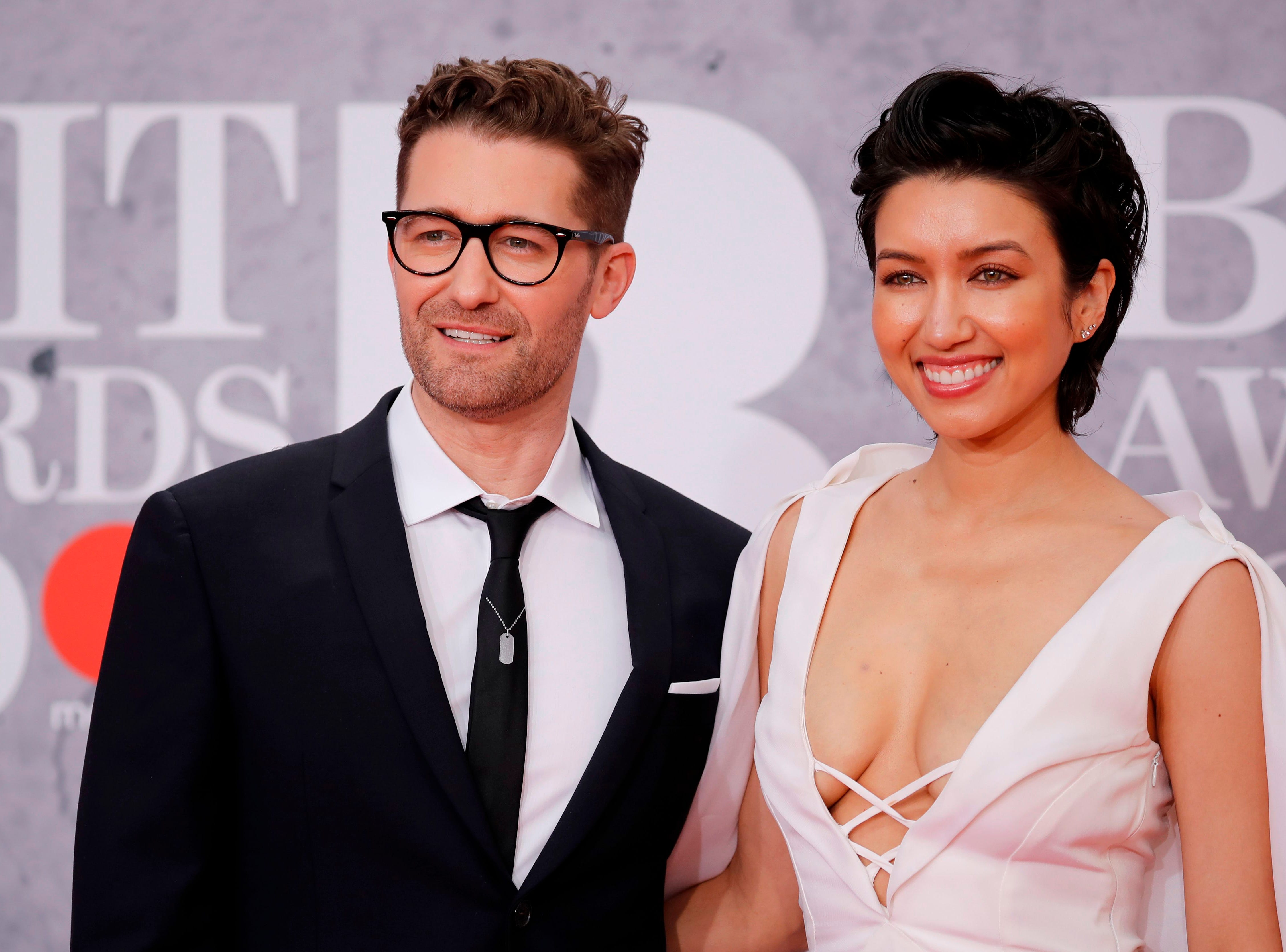 US actors Matthew Morrison (L) and his wife Renee Puente (R) pose on the red carpet on arrival for the BRIT Awards 2019 in London on February 20, 2019. (Photo by Tolga AKMEN / AFP) / RESTRICTED TO EDITORIAL USE  NO POSTERS  NO MERCHANDISE NO USE IN PUBLICATIONS DEVOTED TO ARTISTSTOLGA AKMEN/AFP/Getty Images ORG XMIT: 723 ORIG FILE ID: AFP_1DO0JC