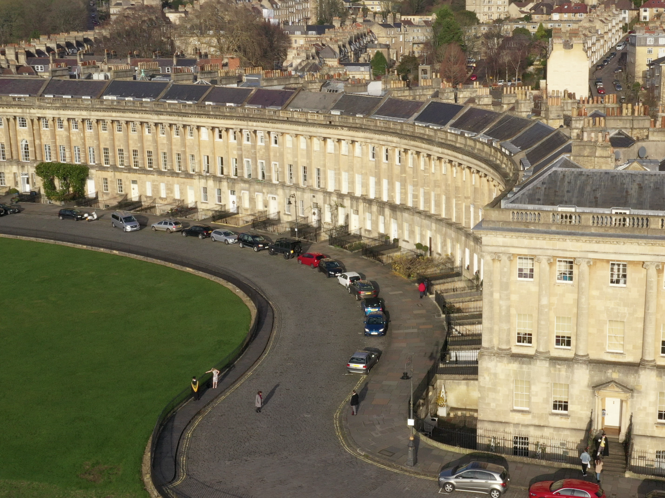 The Royal Crescent, the iconic landmark of Bath.  It forms a perfect half-moon shape around its gardens.