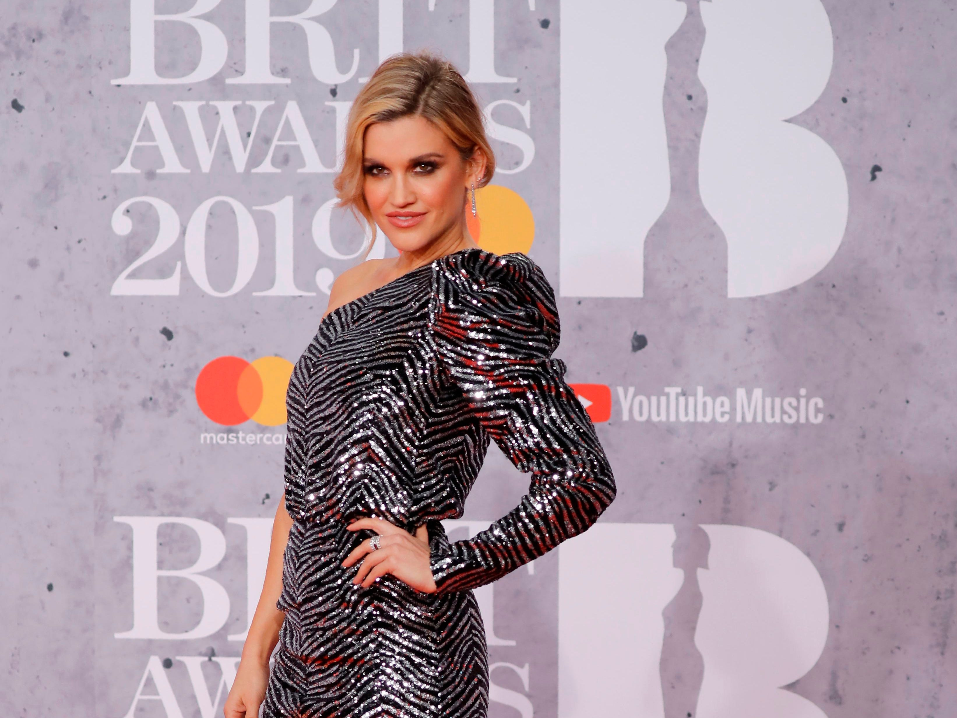 US singer-songwriter Ashley Roberts poses on the red carpet on arrival for the BRIT Awards 2019 in London on February 20, 2019. (Photo by Tolga AKMEN / AFP) / RESTRICTED TO EDITORIAL USE  NO POSTERS  NO MERCHANDISE NO USE IN PUBLICATIONS DEVOTED TO ARTISTSTOLGA AKMEN/AFP/Getty Images ORIG FILE ID: AFP_1DO1BE