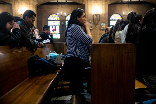 Jessica Maciel Hernandez, 27, the coordinator of the Hispanic youth ministry for the Diocese of Des Moines, attends mass given in Spanish at St. Anthony Catholic Church, Feb. 17, 2019.