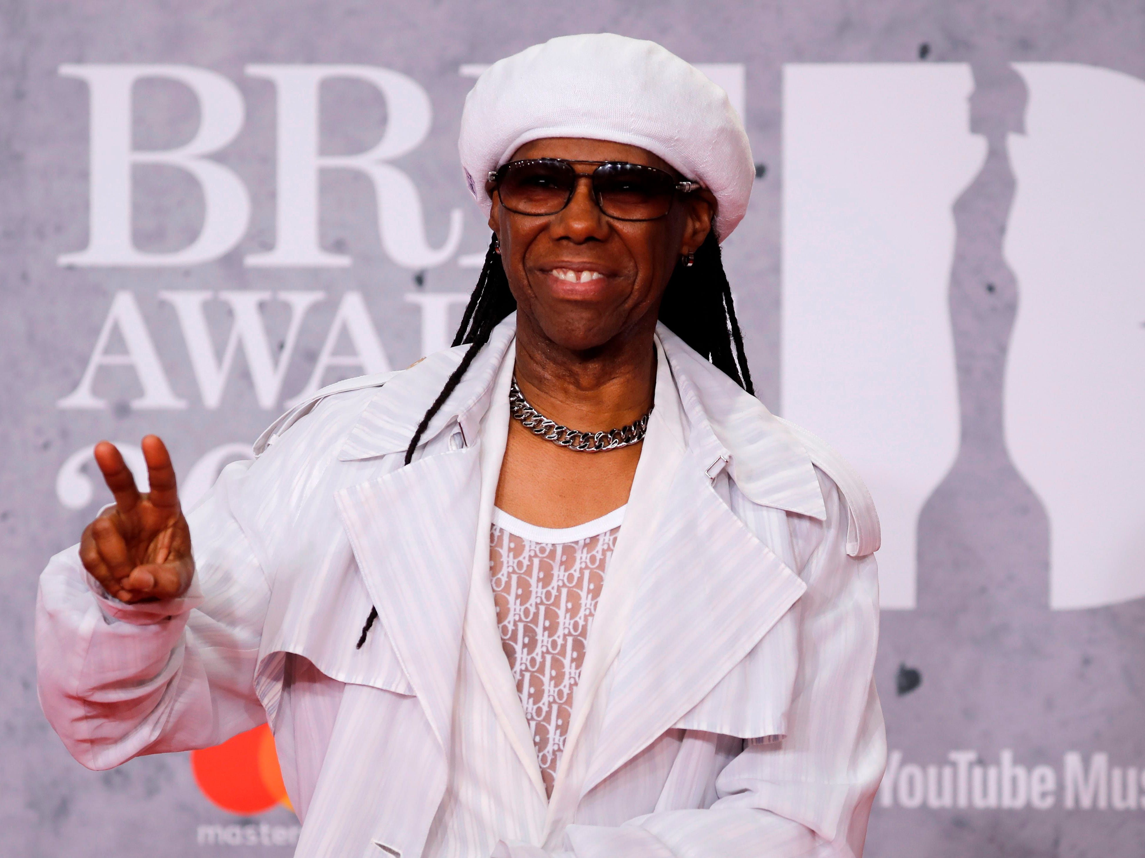 US musician Nile Rogers poses on the red carpet on arrival for the BRIT Awards 2019 in London on February 20, 2019. (Photo by Tolga AKMEN / AFP) / RESTRICTED TO EDITORIAL USE  NO POSTERS  NO MERCHANDISE NO USE IN PUBLICATIONS DEVOTED TO ARTISTSTOLGA AKMEN/AFP/Getty Images ORIG FILE ID: AFP_1DO2DL