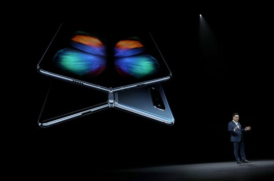 DJ Koh, President and CEO of IT & Mobile Communications Division of Samsung Electronics, announces the new Samsung Galaxy Fold smartphone during the Samsung Unpacked event on Feb. 20, 2019 in San Francisco. Samsung announced a new foldable smart phone.