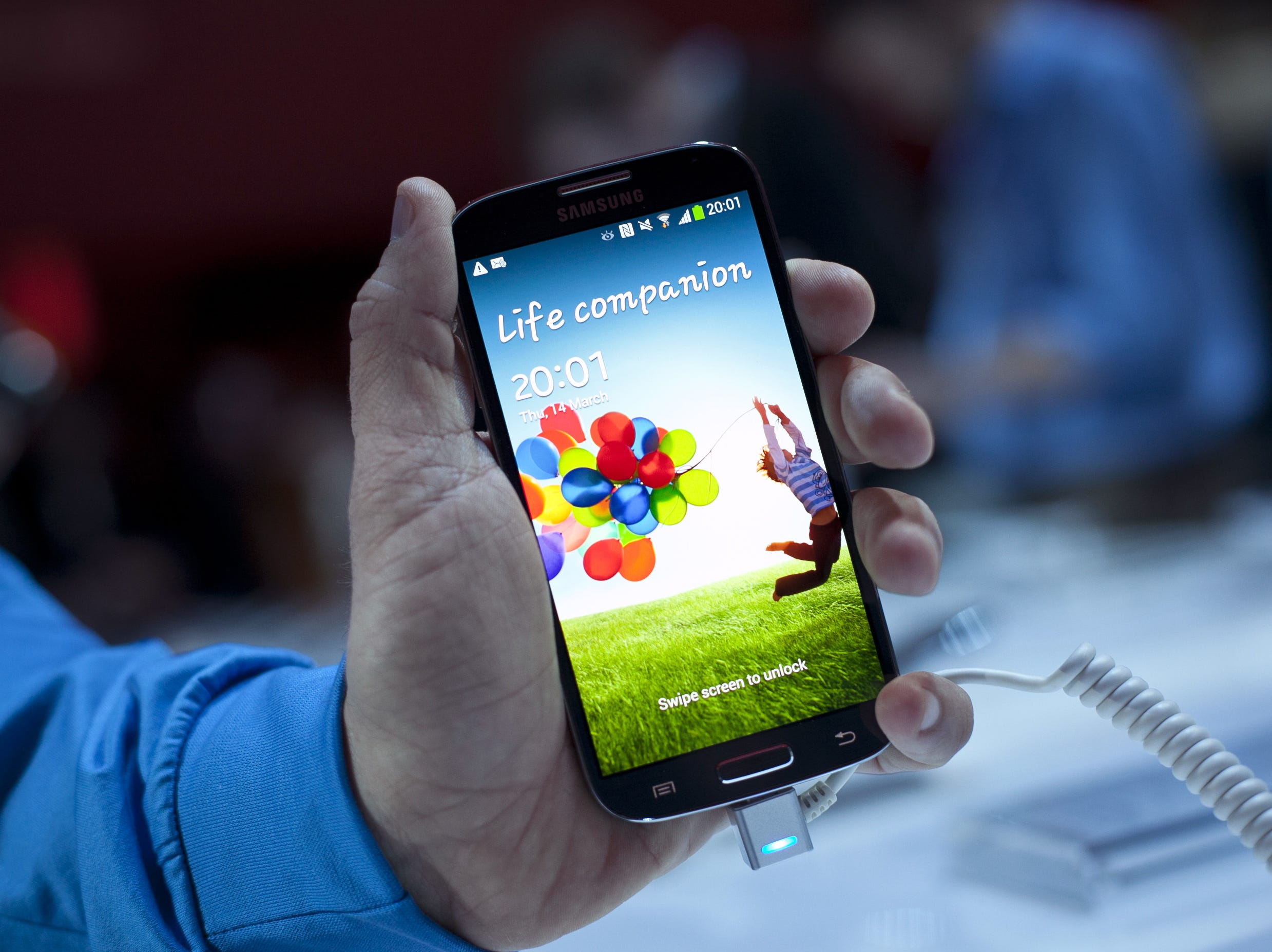 A Samsung employee displays the Samsung Galaxy S IV for a photo March 14, 2013 in New York City. The Galaxy S IV features a five-inch 1080p HD screen, a 1.9GHz quad-core processor, a 13-megapixel rear camera and ships with the Android 4.2.2 Jelly Bean.