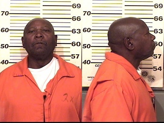 This undated prison photo shows the man Colorado prison officials knew as George Murray, but who prosectors say was actually James Thompson, who stole another man's identity and served multiple prison sentences as him.