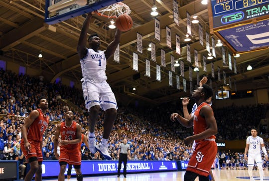 Duke Blue Devils forward Zion Williamson (1) dunks during the second half against the St. John's Red Storm at Cameron Indoor Stadium.