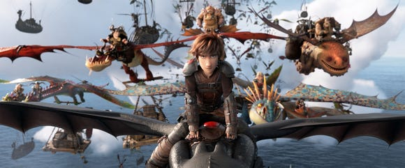 "Hiccup (voiced by Jay Baruchel, center) and his Night Fury dragon Toothless lead the Dragon Riders in ""How To Train Your Dragon: The Hidden World."""
