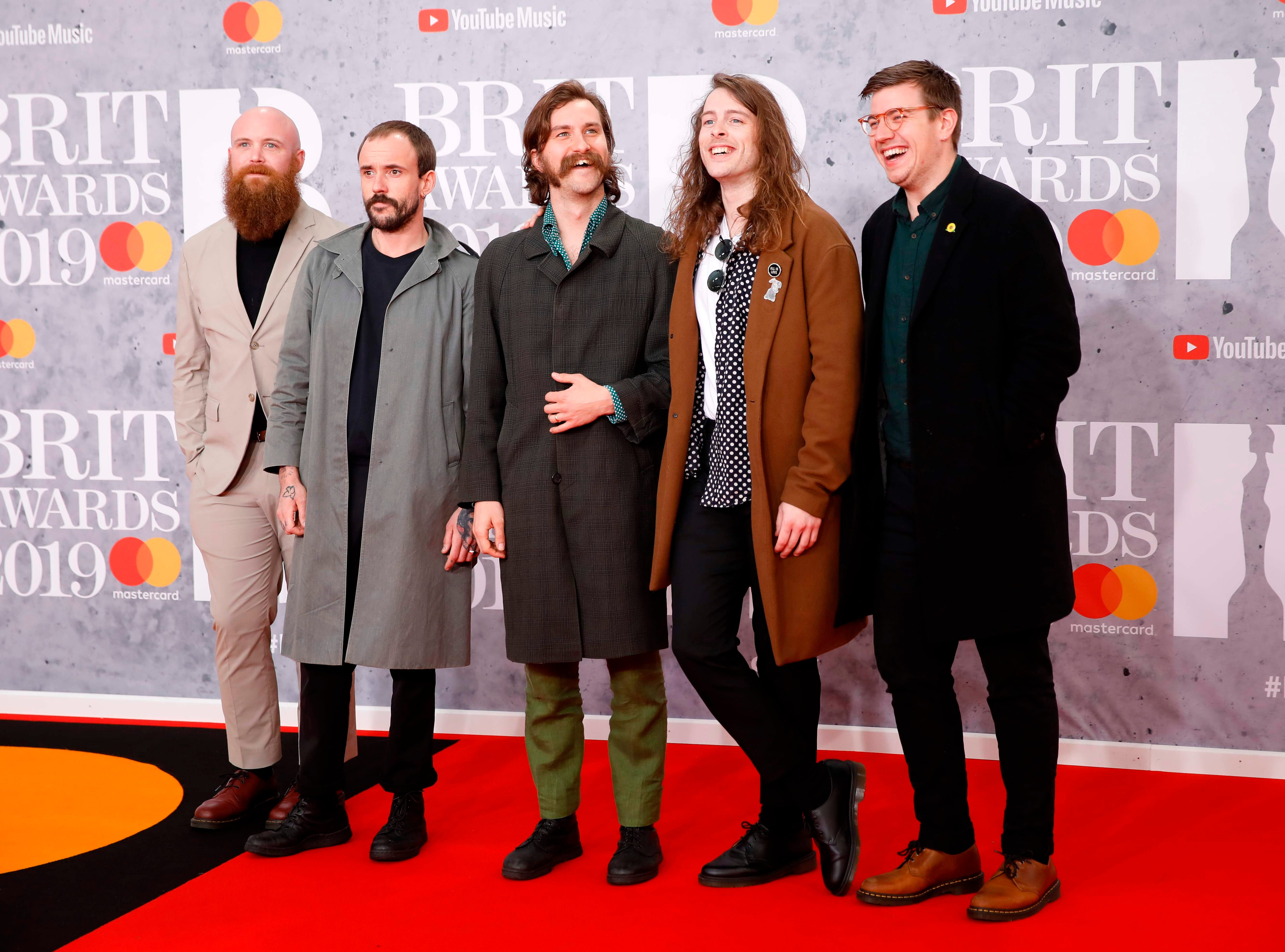 British punk rock band 'IDLES', Joe Talbot, Adam Devonshire, Mark Bowen, Lee Kiernan and Jon Beavis pose on the red carpet on arrival for the BRIT Awards 2019 in London on February 20, 2019. (Photo by Tolga AKMEN / AFP) / RESTRICTED TO EDITORIAL USE  NO POSTERS  NO MERCHANDISE NO USE IN PUBLICATIONS DEVOTED TO ARTISTSTOLGA AKMEN/AFP/Getty Images ORIG FILE ID: AFP_1DO09Z